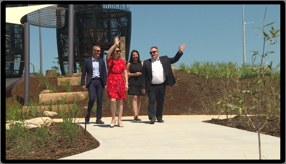 Gladys Berejiklian Adam Crouch waving at Gosford Waterfront Water Park