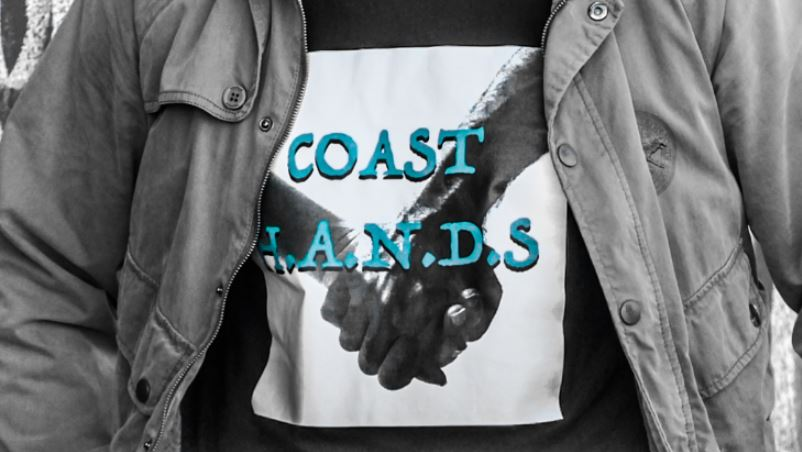 Coast Hands T-Shirt with image of two hands holding in black and white with aqua font
