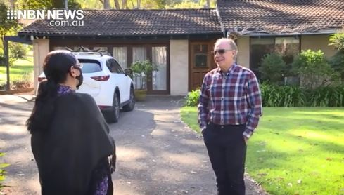 dr ian charlton interviewed by nbn nine reporter sarah el-moselhi, two facing each other, social distancing
